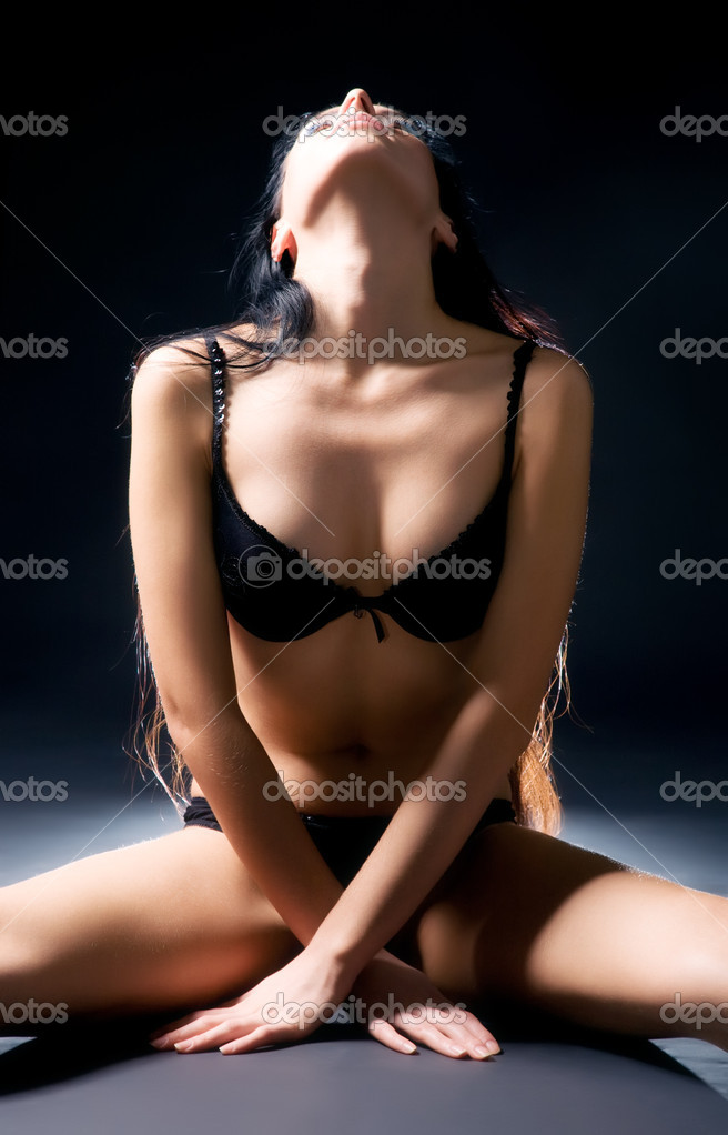 Sexy delighting woman in lingerie. On dark background. — Stock Photo #1194940