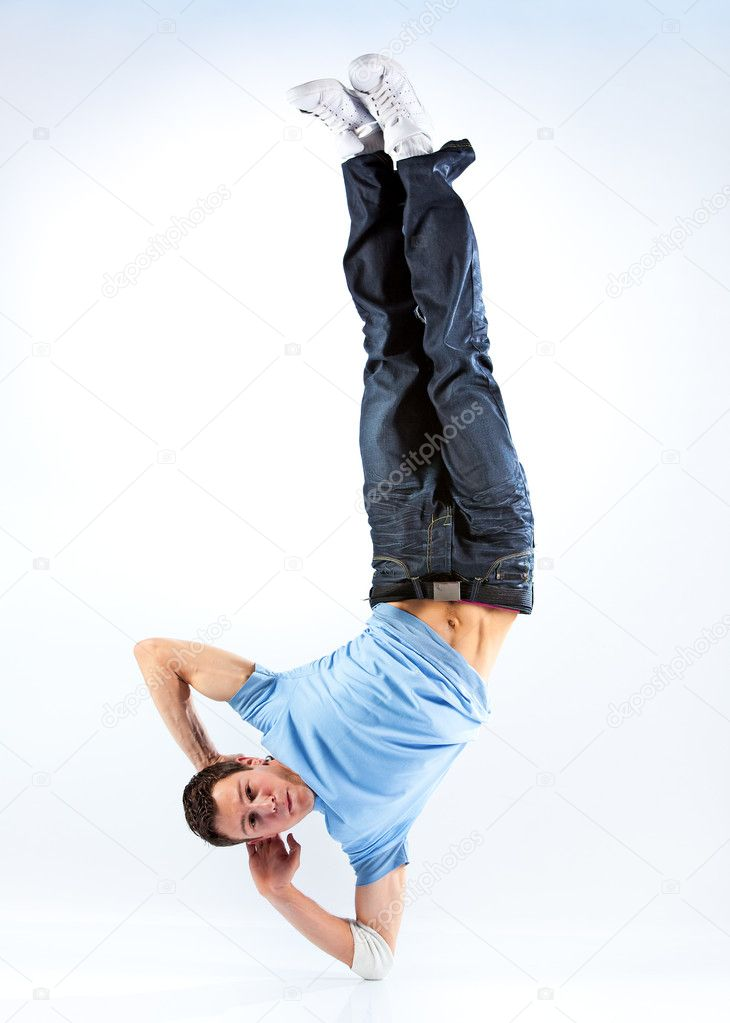 Young man modern dance. Bright white and blue background.  Stock Photo #1195022
