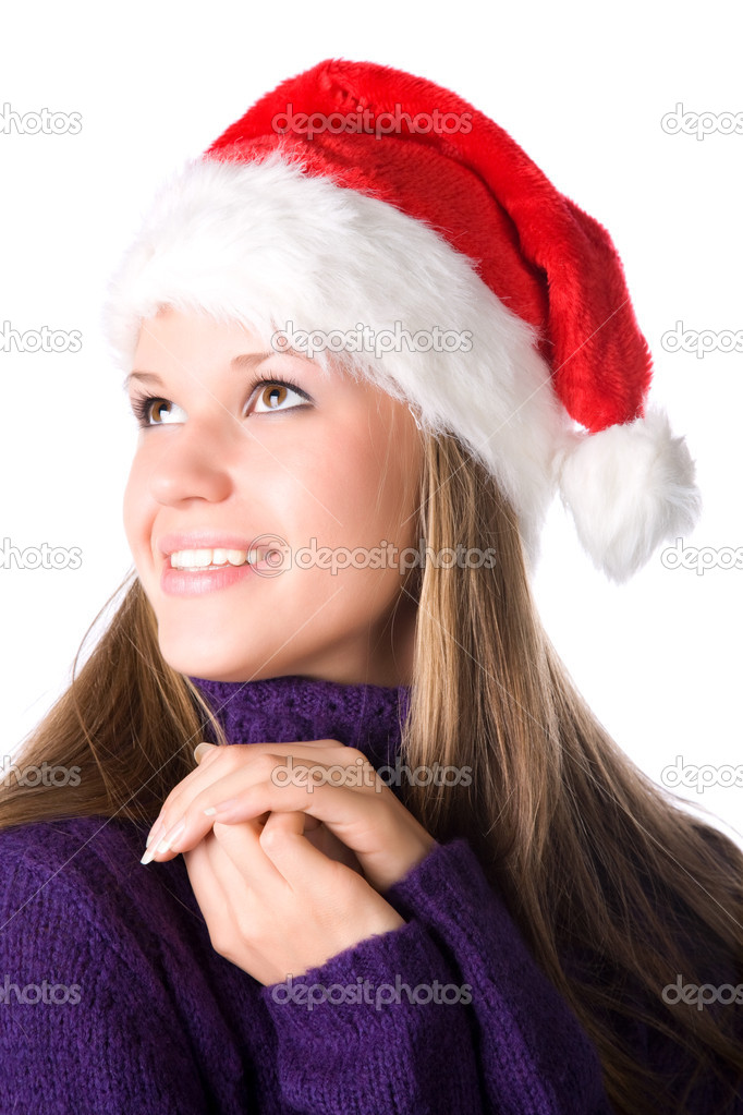 Young smiling woman in santa hat portrait. Isolated on white.  Stock Photo #1195129