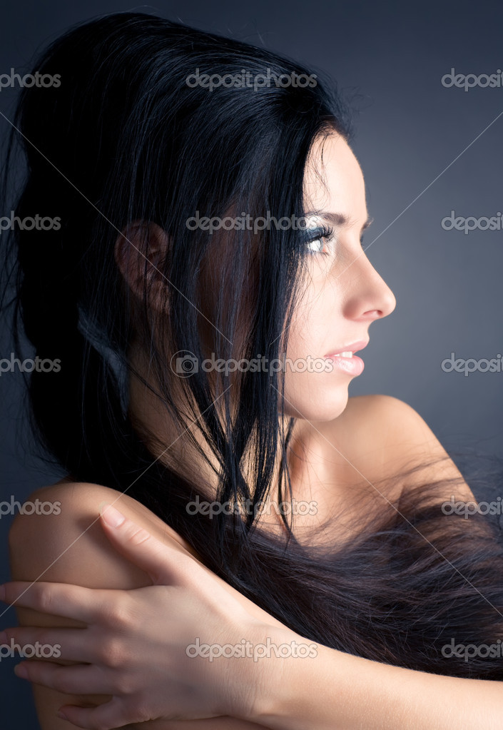 Young brunette woman profile portrait. On dark background. — Stock Photo #1195169