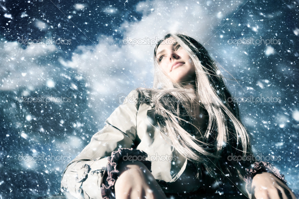 Young blond woman in a blizzard. Wide angle view. — Stock Photo #1195226