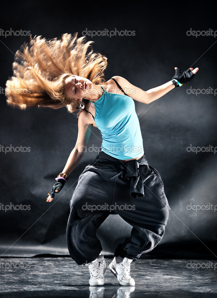 Young woman modern dance. Dark grungy background.  Stock Photo #1195411