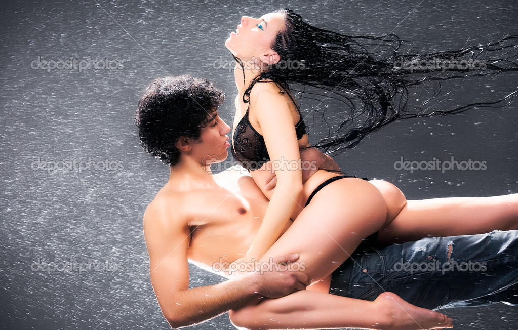 Young sexy couple. Water studio photo.  Foto Stock #1195457