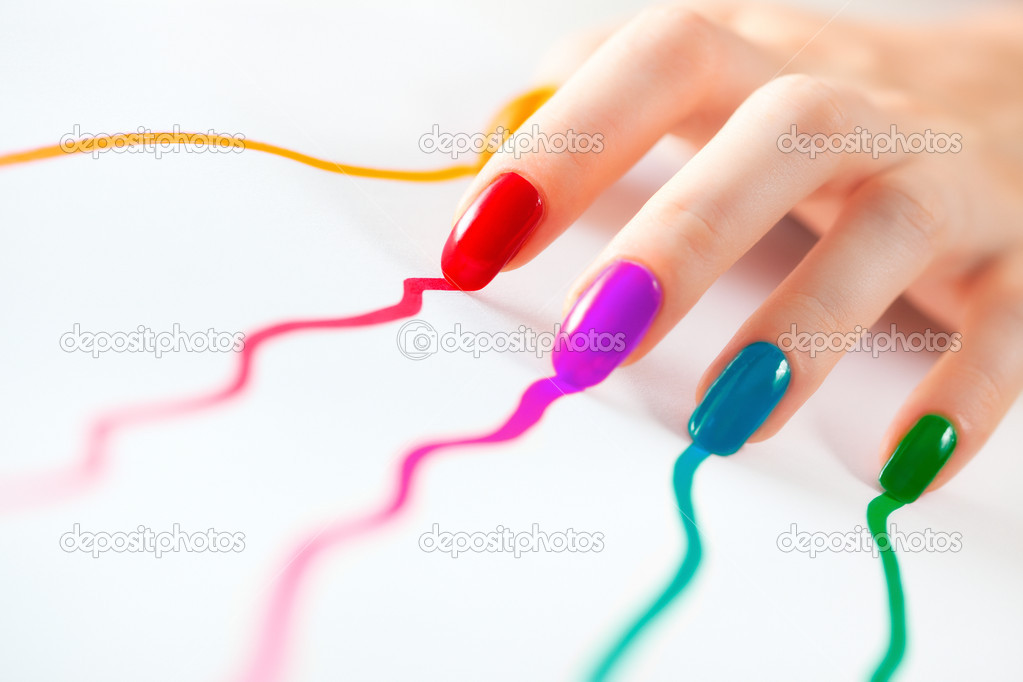 Young woman hand with multicoloured nails. On white. — Stock Photo #1195474