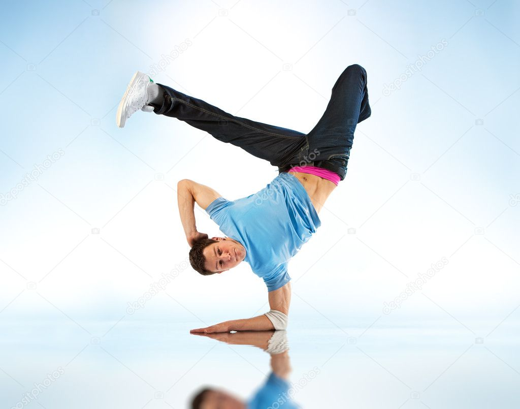 Young man modern dance. On soft white and blue background.  Stock Photo #1195579