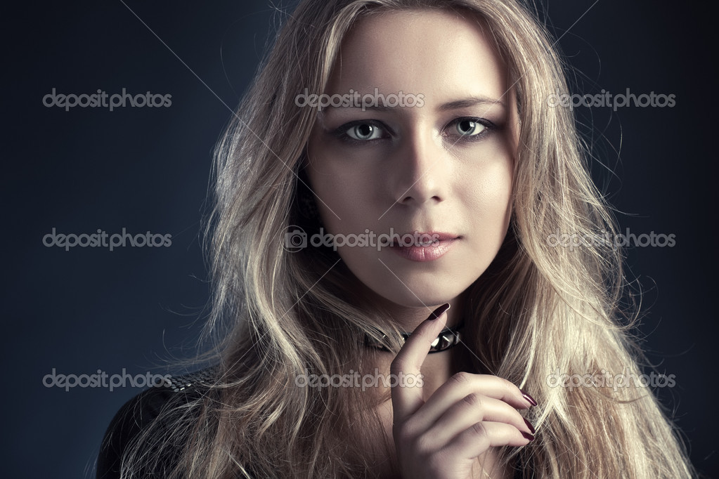 Young woman fashion portrait. On dark background. — Stock Photo #1195583