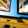 Stock Photo: Looking up to the roofs and sky
