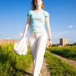 Young independent woman walking - Stock Photo