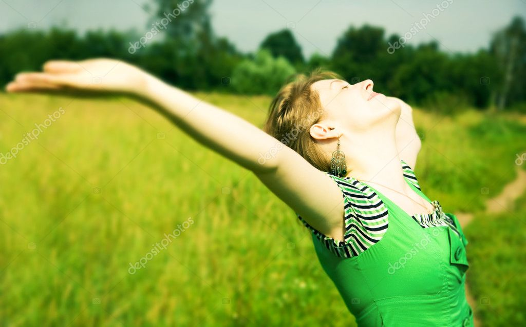 Young happy woman delighting good weather. Soft green tint.  Stock Photo #1328627