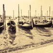 Gondolas at the wharf Venice Italy - Stock Photo