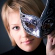 Young woman with mask portrait - Stock Photo