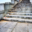Stone stairs with newspapers — Stock Photo