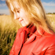 Young woman portrait on field background — Stock Photo