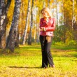Young woman in a park — Foto Stock