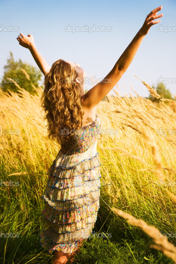 Young woman stretching up in a summer field. — Stock Photo #1332080