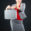 Young woman holding metallic suitcase — Stock Photo