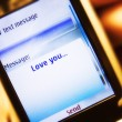 Sms message on mobile phone close-up — Stock Photo #1348294