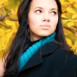 Young brunette woman autumn portrait — Stock Photo #1348311
