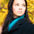 Stock Photo: Young brunette woman autumn portrait