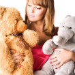 Foto Stock: Young woman with toys