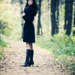 Slim brunette woman walking in a park — Stock Photo