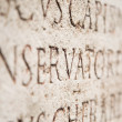 Ancient text on a stone — Stockfoto