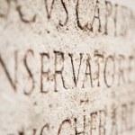 ancien texte sur une pierre — Photo