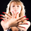 Young woman showing her red nails — Stock fotografie
