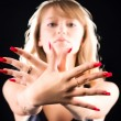 Foto Stock: Young woman showing her red nails