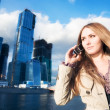 Young businesswoman with mobile phone — Stock Photo