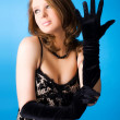 Young woman with elegant gloves — Stock fotografie #1348500