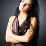 Slim brunette woman looking aside — Stock Photo