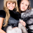 Stock Photo: Two young women with fur coats