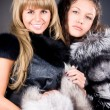 Two young women with fur coats — Stock Photo #1348559