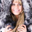 Young woman with fluffy hood — Stock Photo