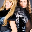Two young women with fur coats — Stock Photo