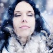 Young woman tender portrait with snow — Stock Photo