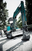 Excavator in a city — Stock Photo