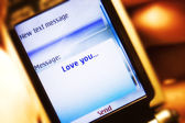 Sms message on mobile phone close-up — Foto de Stock