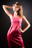 Young slim woman in pink dress — Stock Photo