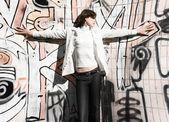 Slim woman on graffiti wall background — Stock Photo