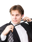 Tired businessman taking off his tie — Stock Photo
