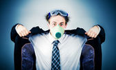 Crazy businessman in protective mask — Stock Photo