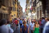 Crowd on a narrow Italian street — Stock Photo