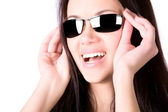 Young smiling woman with sunglasses — Stock Photo