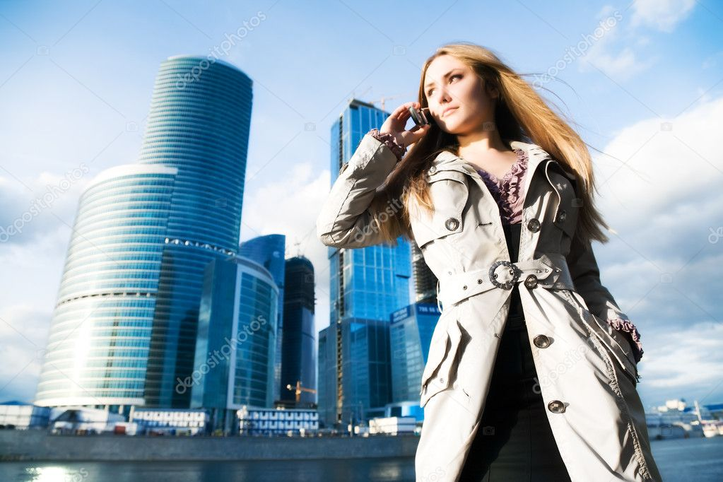 Young businesswoman with mobile phone. On modern city background. — Stock Photo #1348218