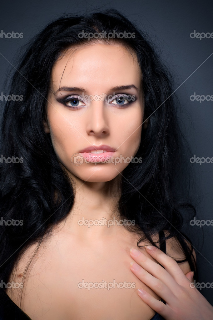Young woman portrait. On dark wall background. — Stock Photo #1348832