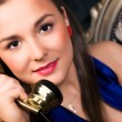 Young woman talking on phone — Stock Photo #1355329