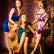 Three women in a luxury interior — ストック写真