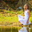 Woman on a river bank — Stockfoto #1355544